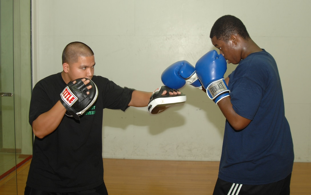 Nate Eaddie spars with Airman 1st Class Reyes at the fitness center Aug. 20. Airman Reyes is the instructor for Incirlik's new boxing course, which focuses on basic technique and endurance training. (U.S. Air Force photo by Senior Airman Benjamin Wilson)