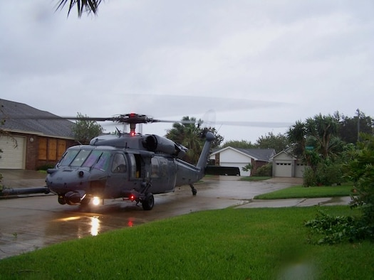 Joint Task Force 129 crew, Jolly 92, from the 129th Rescue Wing, lands in a tight space between houses to rescue an adult male in Galveston, Texas, Sept. 12. The California Air National Guard crew of Jolly 92 rescued six civilians and pets stranded in Galveston. (U.S. Air Force photo by Master Sgt. Wally Bacio)