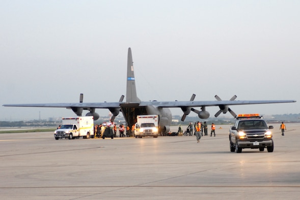 LACKLAND AIR FORCE BASE, Texas -- U.S. Air Force Airmen from the 37th and 59th Air Wing unload hospital patients that were evacuated from Beaumont, Texas, September 12, 2008. These patients were transported by a combined effort from the Little Rock Air Force Base C-130 aircraft and crews and the 908th Aero medical Evacuation Squadron, Scott Air Force Base, IL in preparation for Hurricane Ike's landfall in southern Texas.  (U.S. Air Force photo by Staff Sgt. Chris Willis) (RELEASED)