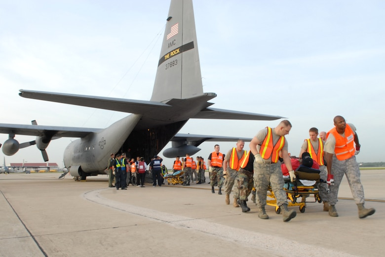 U.S. Air Force Airmen from the 37th and 59th Air Wing unload hospital patients evacuating from Beaumont, Texas, September 12, 2008, in advance of Hurricane Ike making landfall. C-130 Hercules from Little Rock Air Force Base, with aeromedical evacuation crews from the 908th Aeromedical Evacuation Squadron, Scott AFB, helped move vulnerable patients out of the storm's path while maintaining a high level of care during transport. The C-130 is distinct from similar platforms due to its ability to perform diverse roles, including airlift support, aeromedical evacuation missions, and disaster relief missions. (U.S. Air Force photo by Staff Sgt. Chris Willis)