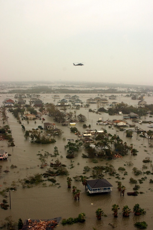 A Joint Task Force 129 crew on board an HH-60G Pave Hawk flies over the Galveston area Sept. 13 on the Gulf Coast of Texas. The JTF 129 crews rescued 48 people and pets stranded in the Galveston area. (U.S. Air Force photo/Tech. Sgt. Brock Woodward)