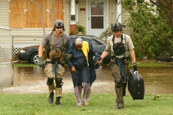 Joint Task Force 129 pararescuemen rescue a hurricane victim Sept. 13 in Galveston, Texas. The JTF 129 crews rescued 48 peoole and pets stranded in the Galveston area. (U.S. Air Force photo/Tech. Sgt. Brock Woodward)