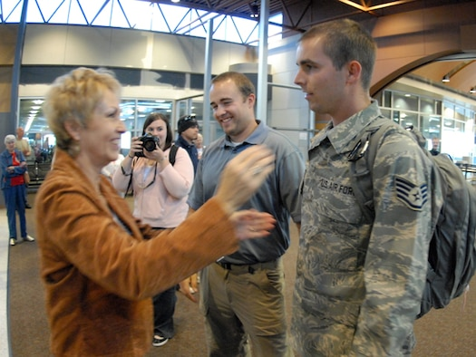 Staff Sgt. James Jennen of the 119th Wing greets his mother at Hector IAP in Fargo N.D. on Sept. 11.  Jennen deployed in Afghanistan in July 2008.