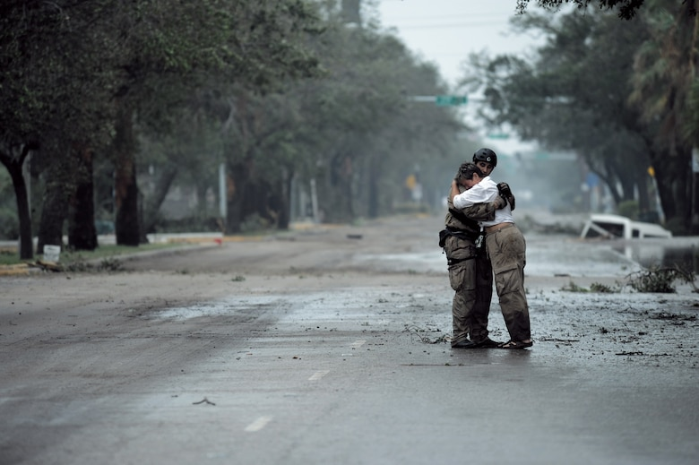 Pararescueman Staff Sgt. Lopaka Mounts receives a hug from a resident during search and rescue operations after Hurricane Ike, Sept. 13. Sergeant Mounts assigned to the 331st Air Expeditionary Group at Randolph Air Force Base, Texas. (U.S. Air Force photo/Staff Sgt. James L. Harper Jr.)