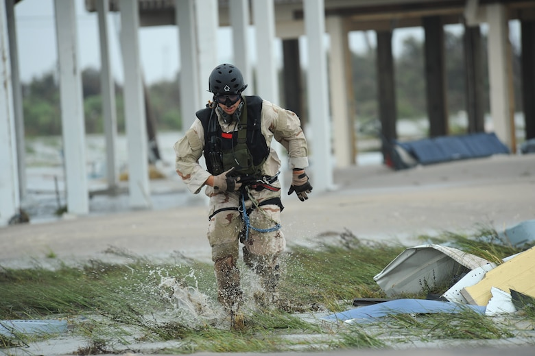 Pararescueman Staff Sgt. Lopaka Mounts conducts search and rescue operations in Galveston, Texas, after Hurricane Ike, Sept. 13. Sergeant Mounts is assigned to the 331st Air Expeditionary Group at Randolph Air Force Base, Texas. (U.S. Air Force photo/Staff Sgt. James L. Harper Jr.)