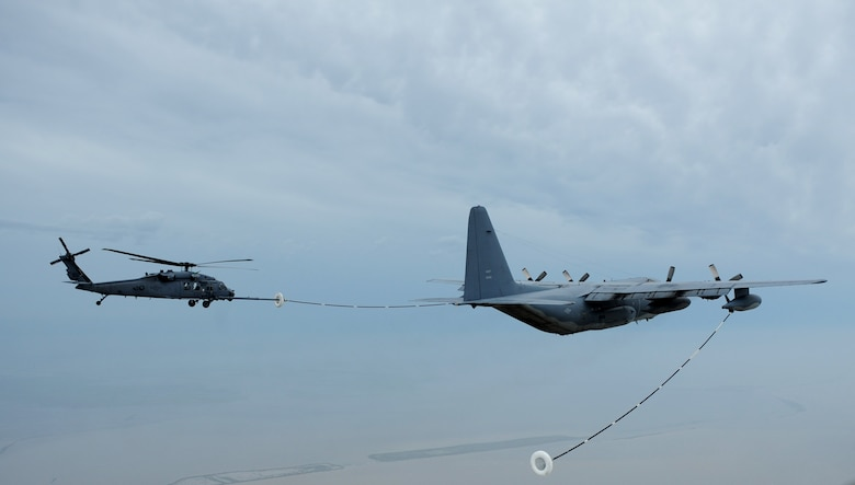 An HH-60 Pave Hawk receives fuel from a HC-130 Hercules during search and rescue operations in Galveston, Texas, after Hurricane Ike, Sept. 13. Both aircraft are assigned to the 331st Air Expeditionary Group at Randolph Air Force Base, Texas. (U.S. Air Force photo/Staff Sgt. James L. Harper Jr.)