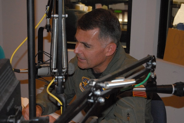 Col. John McDonald, 43rd Airlift Wing Commander, talks about Pope's mission and how it is changing because of BRAC during a radio interview with WFNC radio Aug. 29. (U.S. Air Force Photo by 2nd Lt. Chris Hoyler)