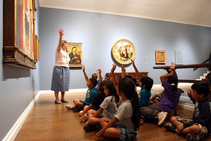 Carolyn Whitney, museum docent, interacts with children from Kapolei Elementry Shool during a school tour of the museum at the Honolulu Academy of Art Sept. 16. School tours must be scheduled ahead of time, but are longer and involve hands on activities, benchmarks and exploration for the children.
