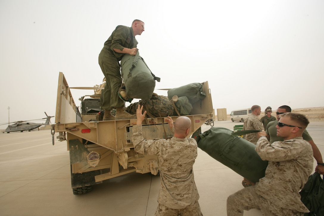 Shortly after arriving at Al Asad, Marines load their gear onto a waiting truck. Four CH-53E Super Stallion helicopters and about 60 Marines from HMM-264 (Rein), the aviation combat element of the 26th Marine Expeditionary Unit, detached from the MEU to support operations at Al Asad.
