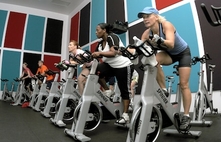 Cycle members go through the motions of a 45-minute spinning class, offered six times a week at Rambler Fitness Center Sept. 15. (U.S. Air Force photo by Rich McFadden)
