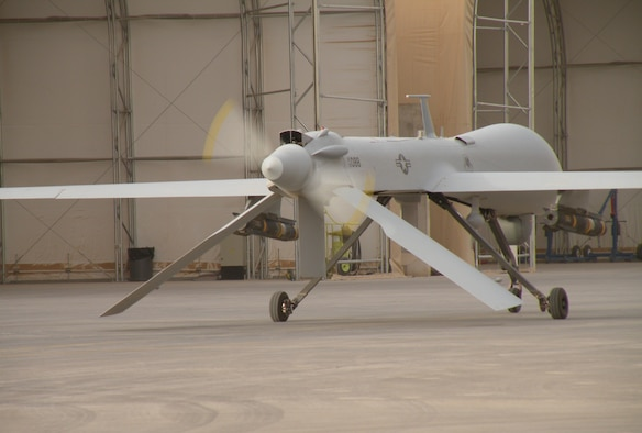 An MQ-1 Predator Unmanned Aircraft System idles at Joint Base Balad, Iraq, after returning from a mission in September, 2008. The Air Force is taking a new approach for developing pilots to sustain the fast-growing need for UAS capabilities. The MQ-1's primary mission is interdiction and conducting armed reconnaissance against critical, perishable targets. (U.S. Air Force photo/Staff Sgt. Scott Gaitley)