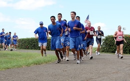 Cadets from the Kalaheo High School Navy junior reserve officer training  corps run in formation during the 12th Annual 5K Grueler Sept. 17.