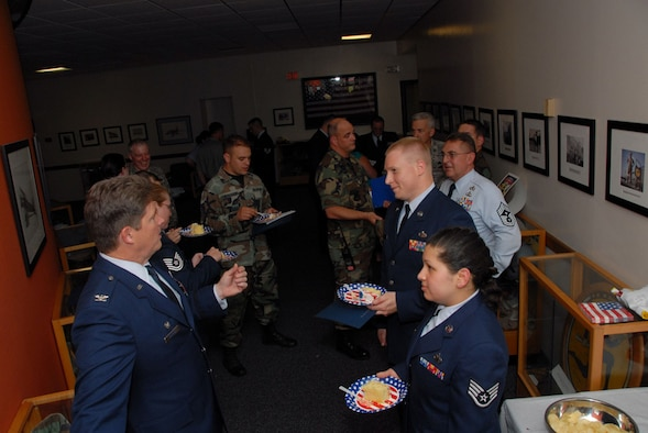 Col. Brian P. Barnes, commander, 103rd Airlift Wing, (left) chats with Community College of the Air Force graduates at a reception following the graduation ceremony at the Connecticut Air National Guard Base, East Granby, Conn. on June 28, 2008.  Col. Barnes was the guest speaker for the event and awarded the CCAF degrees to the graduates.  (U.S. Air Force Photo by Staff Sgt. Nicholas A. McCorkle)