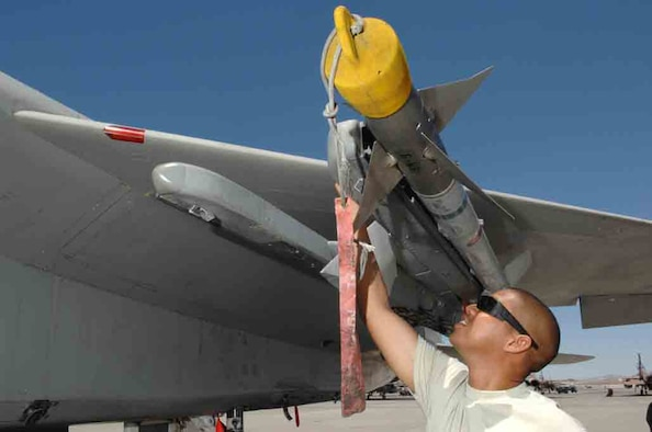 Tech Sgt. John Robles, an F-15 weapons expediter assigned to the 926th Group Detachment 2, performs a supervisory post-load inspection of an AIM-9 missile July 24, 2008 at Nellis Air Force Base, Nev. The 926th Group is an Air Force Reserve unit under 10th Air Force, Naval Air Station Joint Reserve Base, Fort Worth, Texas. The group is located at Nellis AFB as an associate unit to the United States Air Force Warfare Center. Through Total Force Integration, reservists are integrated into regular Air Force units, accomplishing the USAFWC's mission alongside REGAF personnel on a daily basis. (U.S. Air Force Photo/Senior Airman Larry E. Reid Jr., Released)
