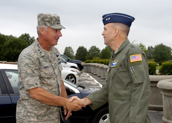Maj. Gen. Ralph Jodice, right, Air Force District of Washington commander, greets Maj. Gen. Winfield W. Scott III, 18th Air Force commander, outside the Headquarters AFDW building Sept. 12.  General Scott, whose headquarters is at Scott Air Force Base, Ill., visited Andrews Air Force Base, Md., as a part of an initial mission brief from the 89th Airlift Wing.  The 89th AW is one of 12 Air Mobility Command wings for which 18th AF is responsible.  (U.S. Air Force photo by Senior Airman Renae Kleckner)
