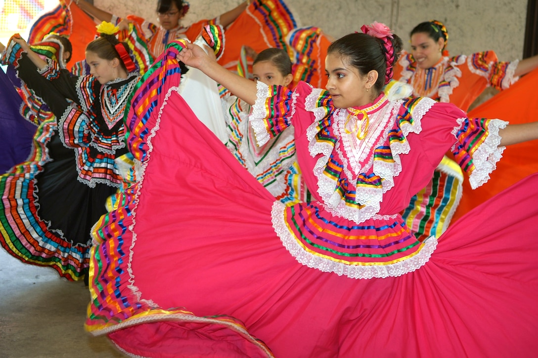 A group of young Mexican folkloric dancers perfrom at Robins' Hispanic Heritage  Month picnic Sept. 13.  The picnic, which was held at Gator Park, featured music,  dancers, piñatas and family games including a children's version of Spanish Bingo. The next Hispanic Heritage Month event will be a luncheon that will be held in the Heritage Club Ballroom from 11 a.m. The keynote speaker will be Col. Madeline Lopez, Defense Logistics Agency Warner Robins commander.  U.S. Air Force photo by Gary Cutrell
