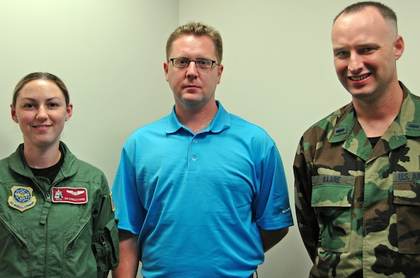 Three new Airmen joined the 931st Air Refueling Group family during the October Unit Training Assembly: (from left to right) Senior Airman Danielle Crone, Tech. Sgt. Bryan Pryor and Chaplain (1st Lt.) Keith Saare.