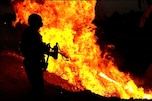 A U.S. Army soldier uses a flamethrower to ignite a controlled fire near Al Anaflsah, Iraq, to eliminate brush from roadsides so bombs cannot be concealed, Sept. 11, 2008. The soldiers are assigned to the 25th Infantry Division's 66th Engineer Company.