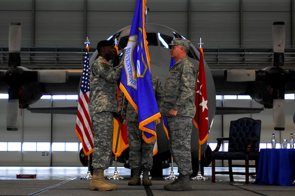 "U.S. African Command Commander Army Gen. William E. ""Kip"" Ward (left) bestows the Seventeenth Air Force guidon to its new commander, Air Force Maj. Gen. Ronald R. Ladnier, in a Sept. 18 assumption of command ceremony at Ramstein Air Base, Germany. Seventeenth Air Force, which officially activates Oct. 1, will serve as the air component for U.S. (U.S. Air Force photo by Airman 1st Class Kenny Holston)(Released)"