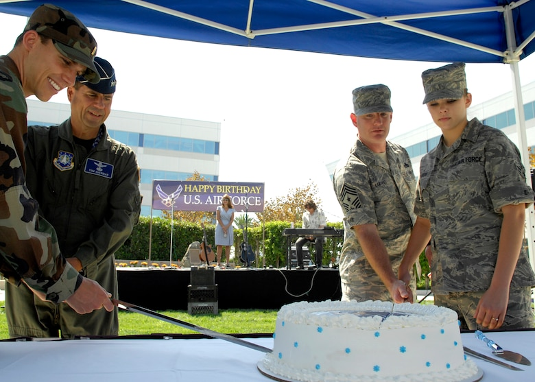 (left to right) The youngest officer on base 2nd Lt Travis Wittick, Space and Missile Systems Center commander Lt. Gen. Tom Scheridan, Command Chief Master Sergeant Chief Stephen Ludwig, and the youngest Airman on base Airman 1st Class Linsy Ellison from the 61st Medical Group, cut the Air Force birthday cake together in the Schriever Space Complex courtyard, Sep. 18. (Photos by Stephen Schester)