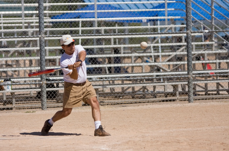 Col. Jose Salinas, wing vice commander, swings away at a pitch during the Junior Enlisted Council's 2008 Softball Tournament here Sept. 20. (Air National Guard photo by Tech. Sgt. Hollie Hansen)