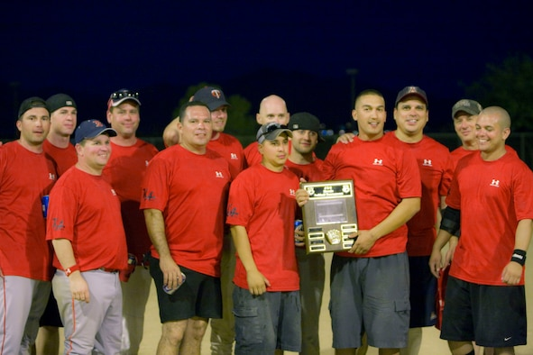 The 162nd Fighter Wing Engine Shop softball team poses for a photo with the JEC Softball Tournament plaque Sept. 20 at Lincoln Park. The team etched their name onto the plaque for winning the tournament's competitive finals. (Air National Guard photo by Tech. Sgt. Hollie Hansen)
