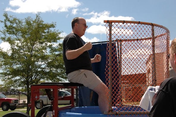 Lt. Col. Kimberly Thompson, 931st Civil Engineer Squadron commander, was among the popular targets sitting above a dunk tank at the 931st Air Refueling Group Family Day Picnic on Sept. 14.  Picnic-goers paid a total of $340 to send Group commanders and chiefs into the tank. (U.S. Air Force photo/Senior Airman Connor Burkhard)