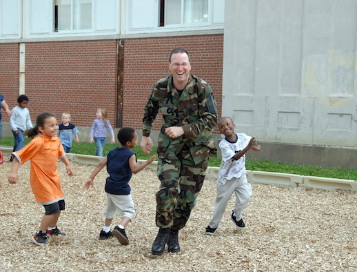 Senior Master Sgt. Christopher Tymula is chased by students as he volunteers his time to spend with students at Yates Elementary School in Schenectady. (U.S. Air Foce photo by Master Sgt. Christine Wood)