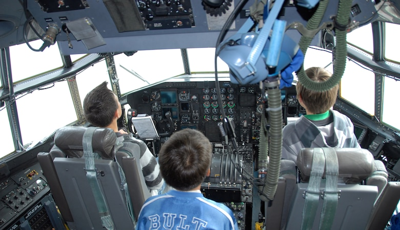 Students in Greenland check out the cockpit of a 109th Airlift Wing LC-130. The tour was part of a community day 109th AW members organized for the elementary school. (U.S. Air Force photo by Master Sgt. Christine Wood)