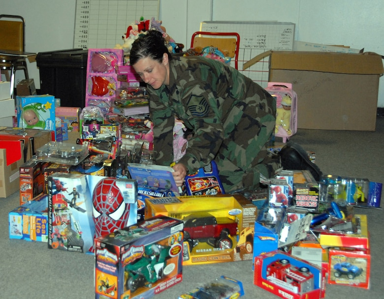 Master Sgt. Kelly Archambeault organizes toys donated by Toys R Us. The toys were handed out to students in Greenland. (U.S. Air Force photo by Master Sgt. Christine Wood)