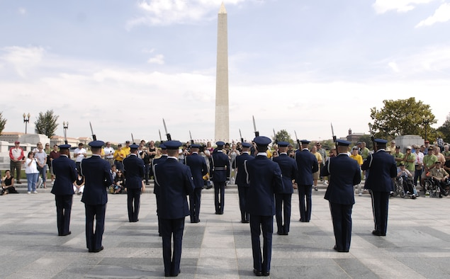 Members of the U.S. Air Force Honor Guard Drill Team stand ready to perform for a crowd Sept. 17 at the World War II Memorial in Washington. The show was a tribute to World War II veterans in attendance and to honor those that lost their lives during World War II. (U.S. Air Force photo by Airman 1st Class Sean Adams)