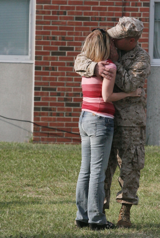 Corporal Matthew J. Chapman, an rifleman with Company G, 2nd Battalion, 9th Marine Regiment, spends his last few minutes saying goodbye to his wife before leaving in support Operation Iraqi Freedom. Marines from 2nd Battalion, 9th Marines are deploying to Al Anbar province to support Iraqi forces in security operations.