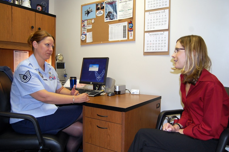 Tech. Sgt. Jenifer Kuhl, 131st Mission Support Flight DPMR officer recruiter, explains to Jennifer Weier, potential officer candidate, the process she would go through to become an officer.  Sergeant Kuhl is working primarily with civilians and servicemembers looking to become officers. (Photo by Airman 1st Class Jessica Donnelly)