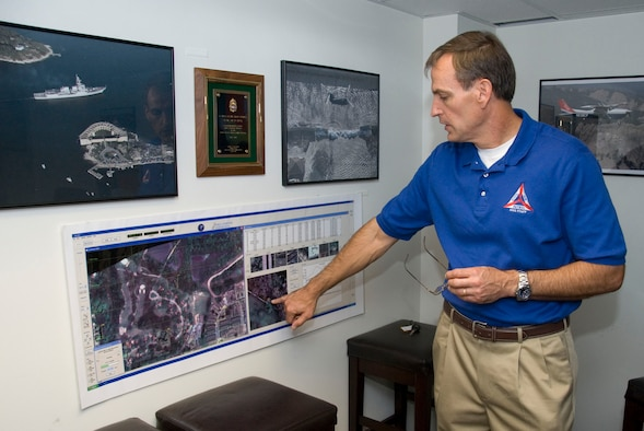 John Salvador, Civil Air Patrol's director of operations, describes the image capabilities of the Airborne Real-Time Cueing Hyperspectral Enhanced Reconnaissance system at the CAP National Operations Center here Sept. 16. The system is used to conduct aerial surveys for rescue missions. (Air Force photo by Jamie Pitcher)