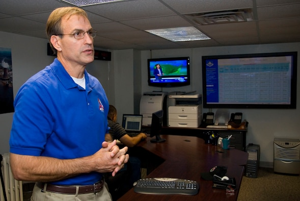 John Salvador, Civil Air Patrol's director of operations, explains the capabilities of the CAP National Operations Center here Sept. 16. The center is CAP's communication hub during disaster relief operations. (Air Force photo by Jamie Pitcher)