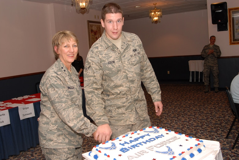 Maj. Gen. K. C. McClain, Air Force Personnel Center commander, Randolph Air Force Base, Texas, and Airman Dylan Strom, 314th Communications Squadron, cut a cake during the Air Force Birthday at Little Rock AFB on September 18, 2008. (U. S. Air Force photo by Airman 1st Class Jim Araos)