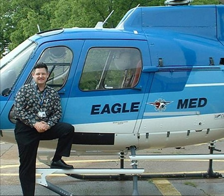 Maj. Mark Rogers, a senior hospital administrator with the 507th Medical Squadron poses beside an air ambulance while working at his civilian job as the Chief Executive Officer of the Pushmataha Hospital in Antlers, Oklahoma.  The Air Force reservist was recently selected to serve on an Oklahoma State Health Care Commission.