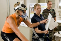 Kassi Micak participates in the citrulline malate study conducted by Air Force Research Laboratory officials Aug. 19 at Brooks City-Base, Texas. Her perceived level of exertion is evaluated while Tech. Sgt. Darci Rose, an aerospace physiology technician, records exertion, lactates, VO2 max and heart rate during the study. Ms. Micak, a competitive cyclist based in San Antonio, volunteered for the study. (U.S. Air Force photo/Steve Thurow)