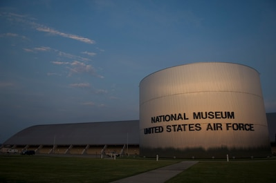 Front view of the National Museum of the U.S. Air Force in twilight.