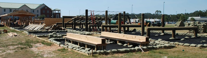 "MATSG-21's Combat Conditioning Course under construction in September 2008. In front, ammo can step-up circuit course station. On the far left, one of two MCMAP ""dojo's."" Stretching from one end to the other is the Marine Corps certified obstacle course."