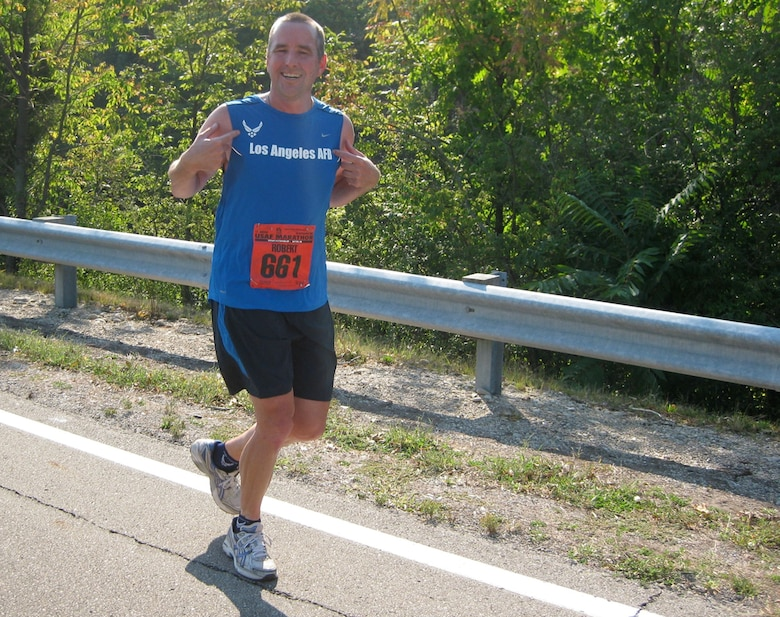 Maj. Bob Frank shows his LAAFB Team pride during 12th Annual Air Force Marathon held at Wright-Patterson AFB, Sept. 20. The major finished the race in 3 hours, 36 minutes.
