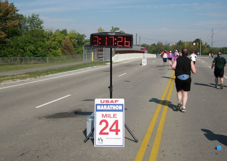 Runners pass by the 24-mile marker on their way to the finish line.