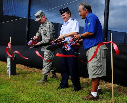 ANDERSEN AIR FORCE BASE, Guam - Colonel Mark Talley, Brig. Gen. Phil Ruhlman, and Ray Stiers cut the ribbon at the grand opening ceremony of the new paintball complex here Sept. 26. Construction on the facility began in January. (U.S. Air Force photo by Airman 1st Class Courtney Witt)