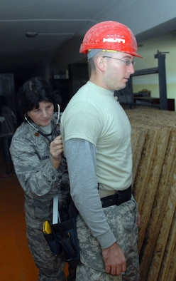 Lieutenant Daniel Simmons, of the Hawaii Army National Guard's 871st Engineering Battalion (Wailuku, Hawaii), receives a check of his lungs from Major Corinne Olivera, a physician's assistant with the Alaska Air National Guard's 176th Medical Group at Alton Bulaag, Mongolia during the field training exercise Khaan Quest 2008, a United Nations multinational peace support exercise at Camp Five Hills Training Center near Ulaan Baatar. Alaska Air National Guard photo by MSgt Jules Barklow.