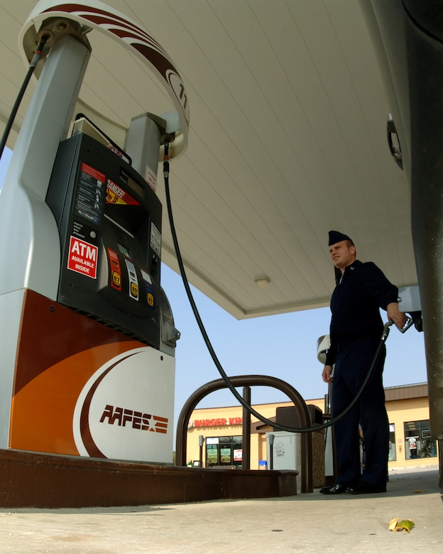 Staff Sgt. Matthew Simmons, 55th Communications Squadron, fills his gas tank at one of Offutt's Army and Air Force Exchange Service stations Sept. 22.  Most people, including Sergeant Simmons, are feeling the financial pinch caused by higher gas prices. (U.S. Air Force Photo By Tech. Sgt. Rhonda Moraski)