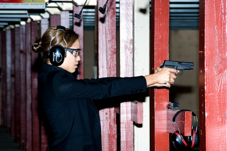 Rosario Dawson is about to fire a M11 pistol at the firing range at Andrews Air Force Base, Md. Ms. Dawson was at the base researching her role as a Special Agent with the Air Force Office of Special Investigations in the movie 'Eagle Eye.' (U.S. Air Force photo/Mike Hastings)