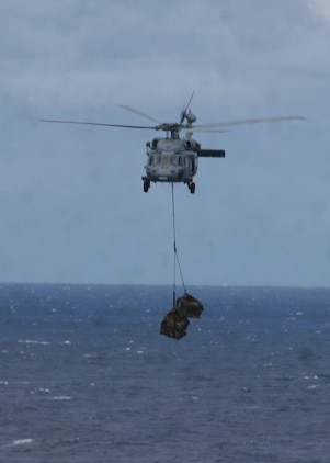ABOARD USS PELELIU (LHA-5), (Sept. 29, 2008)- A MH-60S Seahawk helicopter flies with supplies to the flight deck of USS Peleliu during a vertical replenishment, Sept. 29. Vertical replenishments are designed to resupply a Peleliu using helicopters to transport supplies from one ship to another.::r::::n::The Camp Pendleton, Calif., based 15th MEU is embarked aboard USS Peleliu and is comprised of approximately 2,200 Marines and Sailors and is a forward deployed force in readiness capable of conducting numerous operations, such as Non-Combatant Evacuation Operations, Humanitarian Assistance Operations and range of amphibious missions.  The MEU is currently deployed aboard USS Peleliu (LHA-5), USS Dubuque (LPD-8) and USS Pearl Harbor (LSD-52).   (Official USMC photo by Cpl Stephen Holt)::r::::n::