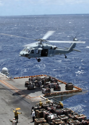 ABOARD USS PELELIU (LHA-5), (Sept. 29, 2008)- A MH-60S Seahawk helicopter drops supplies onto the flight deck of USS Peleliu during a vertical replenishment, Sept. 29. Vertical replenishments are designed to resupply a Peleliu using helicopters to transport supplies from one ship to another.::r::::n::The Camp Pendleton, Calif., based 15th MEU is embarked aboard USS Peleliu and is comprised of approximately 2,200 Marines and Sailors and is a forward deployed force in readiness capable of conducting numerous operations, such as Non-Combatant Evacuation Operations, Humanitarian Assistance Operations and range of amphibious missions.  The MEU is currently deployed aboard USS Peleliu (LHA-5), USS Dubuque (LPD-8) and USS Pearl Harbor (LSD-52).   (Official USMC photo by Cpl Stephen Holt)::r::::n::