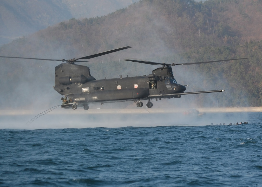 NEAR CHINHAE, Republic of Korea -- Crew members throw a rope ladder out the back of a U.S. Army MH-47 helicopter from the 160th Special Operations Aviation Regiment (Airborne) to retrieve members of the 320th Special Tactics Squadron from the water during an infiltration/exfiltration training mission here March 20 during Foal Eagle 2009.  Foal Eagle is an annual combined training exercise for U.S. and Republic of Korea forces to evaluate and improve their ability to coordinate procedures, plans and systems necessary to defend the ROK. The 320th STS is deployed from Kadena Air Base, Japan, and the 160th SOAR is deployed from Fort Lewis, Wash. (U.S. Air Force photo by James D'Angina)