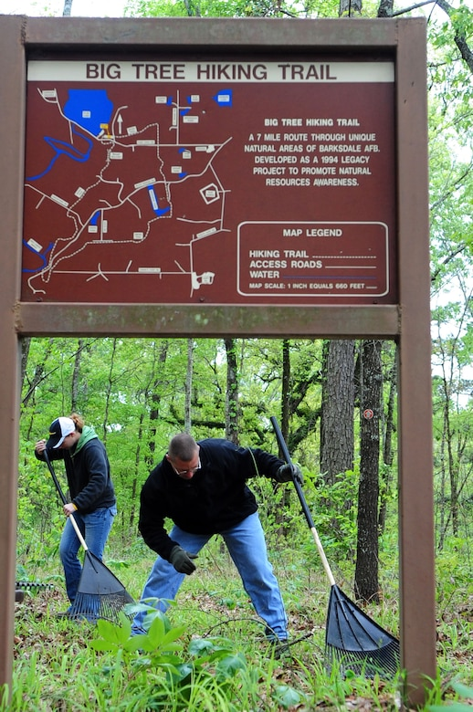 Trail restoration volunteers clear the trail head picnic area of the Big Tree Hiking Trail. (U.S. Air Force photo by Senior Airman Joanna M. Kresge)